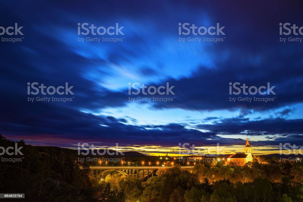 Viaduct and a church in sunset. stock photo