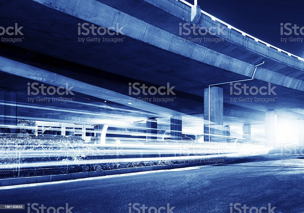 Viaduct and light track stock photo