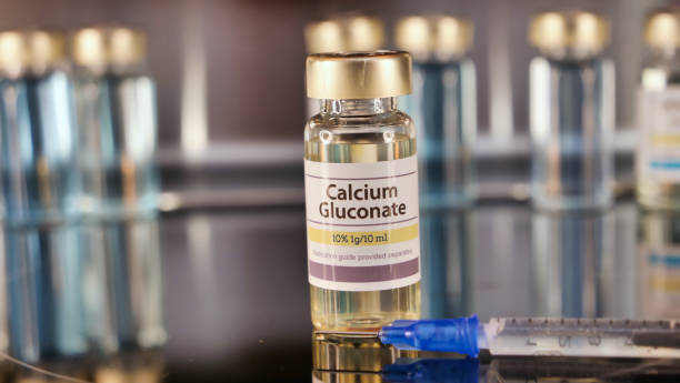 Vial of Calcium Gluconate stainless steel background stock photo