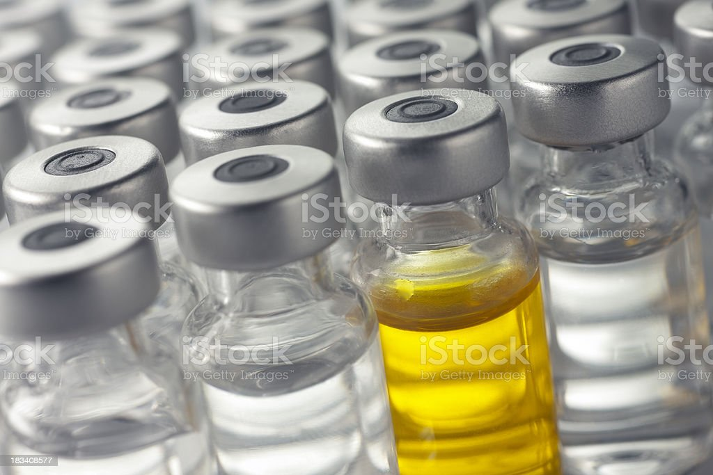 Vial of yellow medicine or vaccine royalty-free stock photo