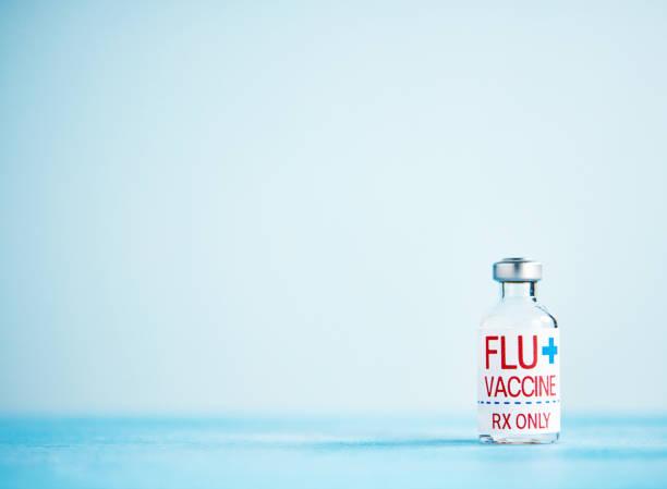 Fläschchen Sie mit Grippe-Impfstoff und Kopie – Foto