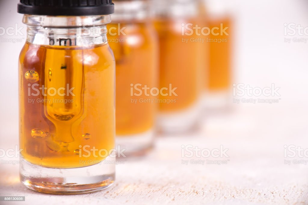 Vials of CBD oil, cannabis live resin extraction isolated on white - medical marijuana concept stock photo