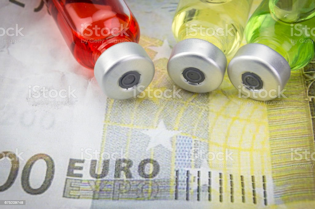 vials with different substances over euros, concept of copayment royalty-free stock photo