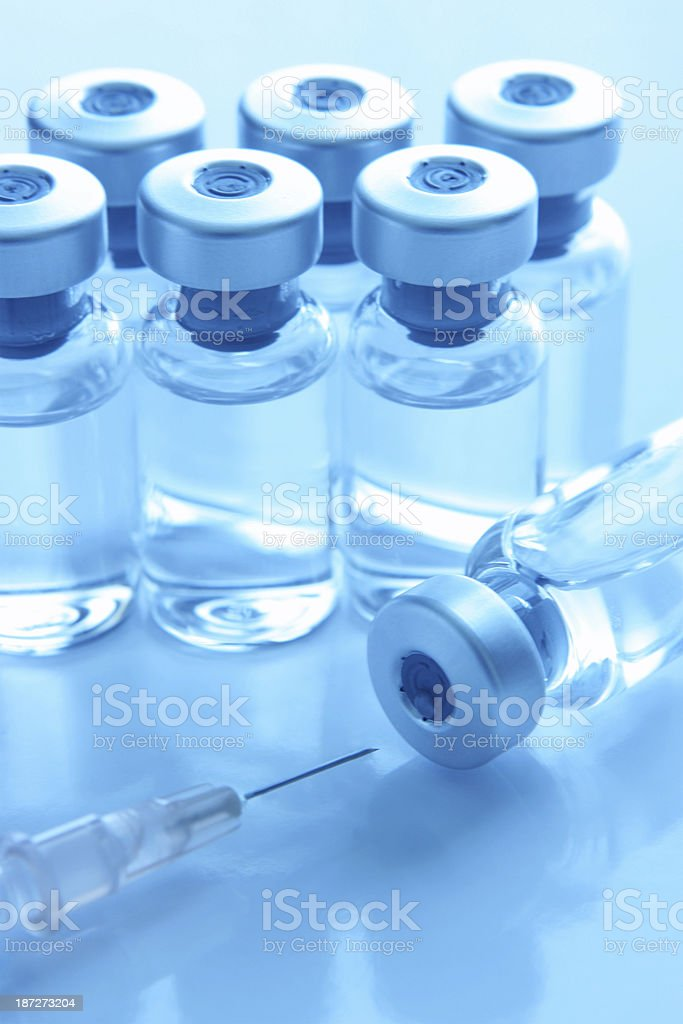 Vials with medication and a syringe ready for injection royalty-free stock photo