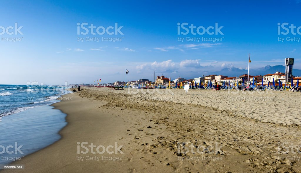 Viareggio beach with colorful umbrellas sunset.Tuscany,Viareggio, Italy.Versilia cost panorama. stock photo