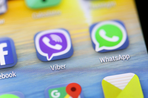 Novi Sad, Serbia - December 16, 2015: Various apps (Facebook, Viber, WhatsApp, Google Maps, Email) on an android smartphone touchscreen, with two popular messaging apps Viber and WhatsApp in the center