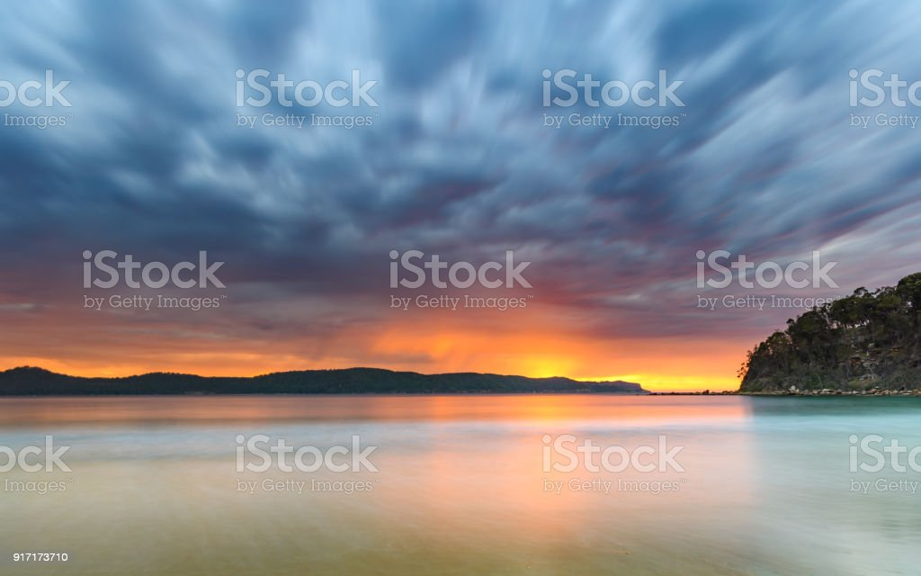 Vibrant and Cloudy Sunrise Seascape stock photo