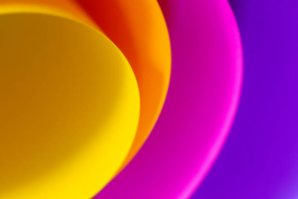 Vibrant and colorful abstract background image, with bold colors, soft curves and copy space. Design element artistic creative backdrop photography. Curved paper layered and overlapped to create depth and design. stock photo