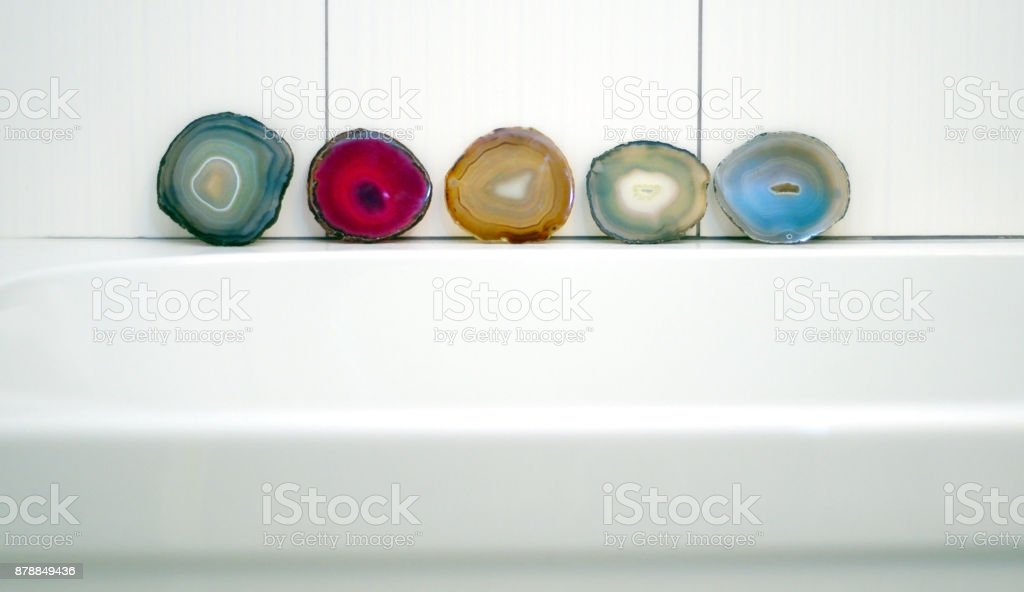 Vibrant and shiny agate rock slices in bathroom stock photo