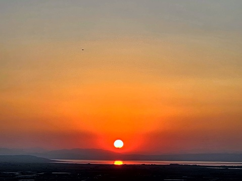 Natural background vibrant autumnal sunset reacting off Utah Lake in distance. Springville, Utah, USA.