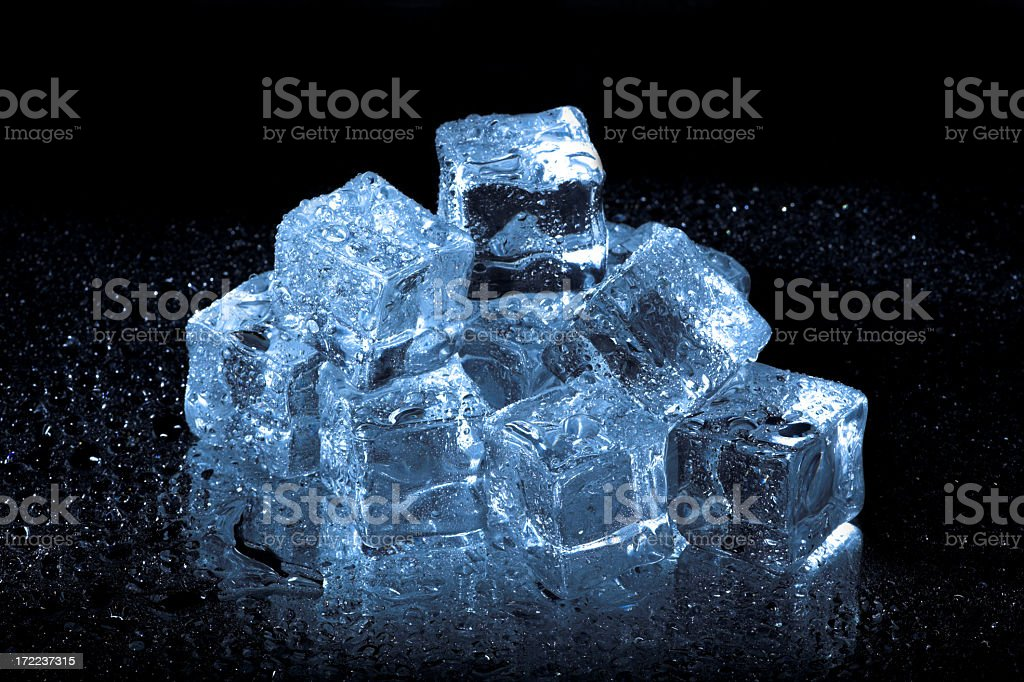 Vibrant blue ice cubes on black royalty-free stock photo