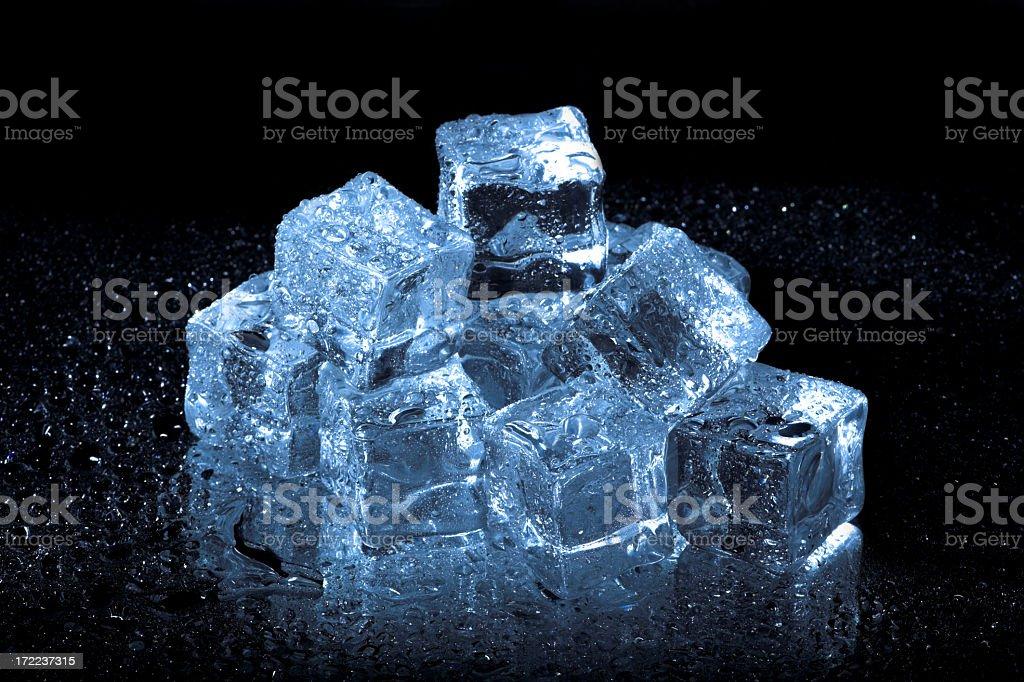 Vibrant blue ice cubes on black stock photo