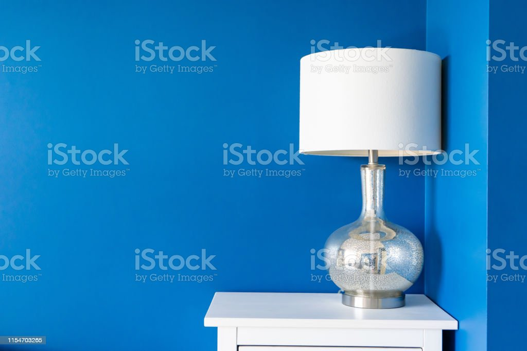 Vibrant Blue Painted Wall With White Home Decor Accents Room For Text And Background Copy Stock Photo Download Image Now Istock
