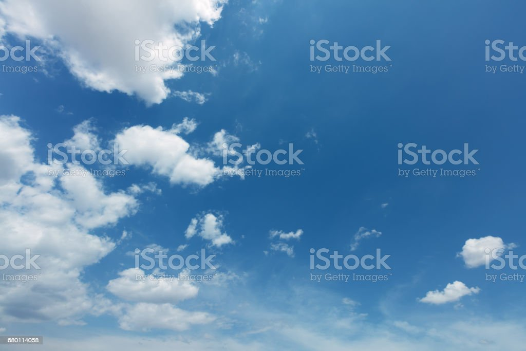 Vibrant blue summer sky background stock photo