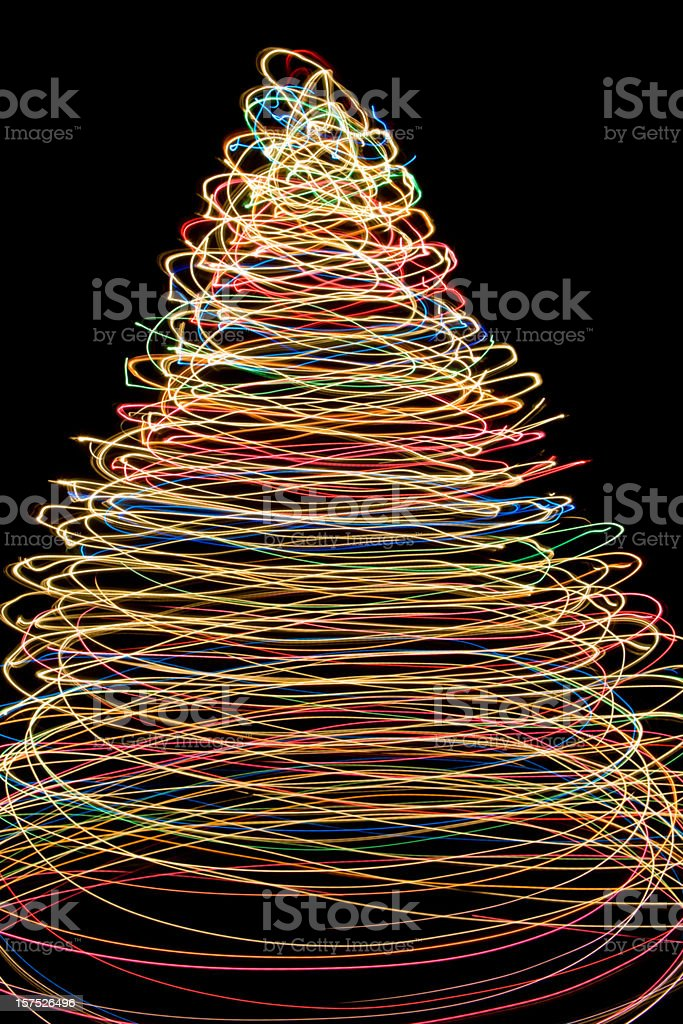 Concentric circle holiday lights form a tree against a black...