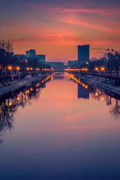Vibrant cityscape shot early morning before sunrise stock photo