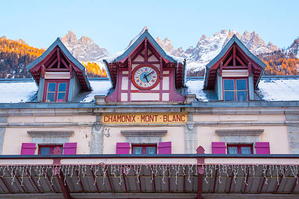 Vibrant color Facade of Chamonix train station and mountain peaks stock photo