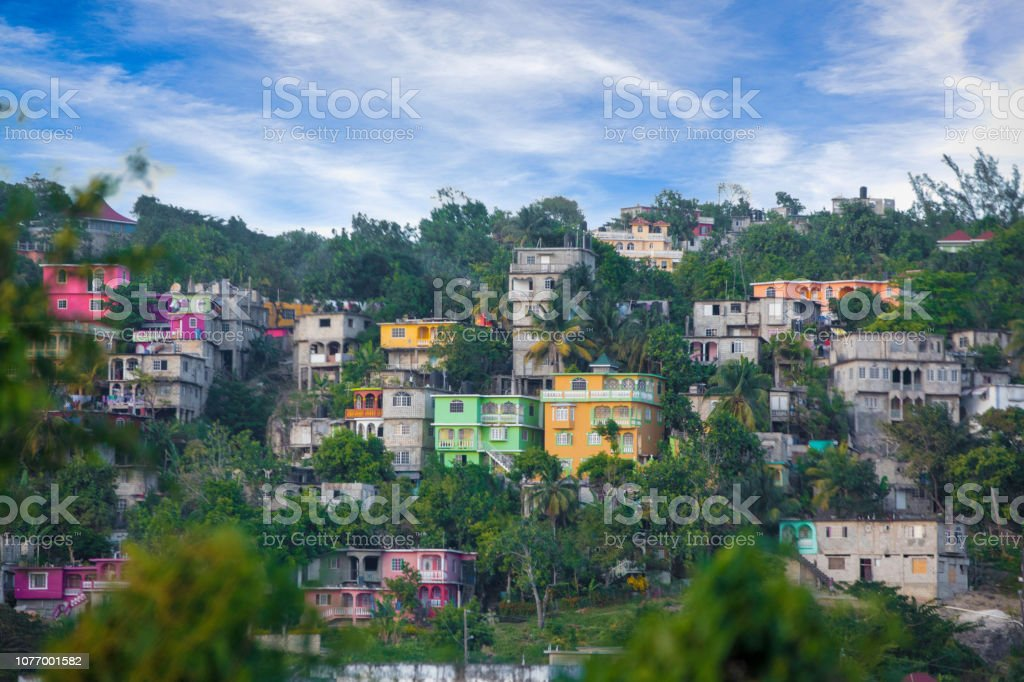 Vibrant color houses on hillside in Jamaica stock photo