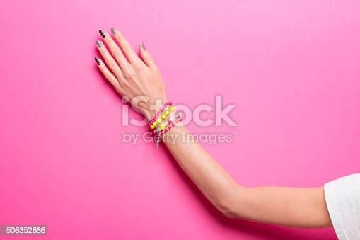 istock Vibrant Color, one hand hand, wearing jewelry. 506352686
