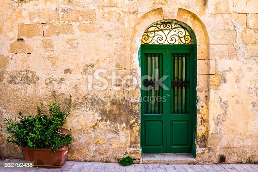 istock Vibrant colored doors and old weathered architecture 932752438
