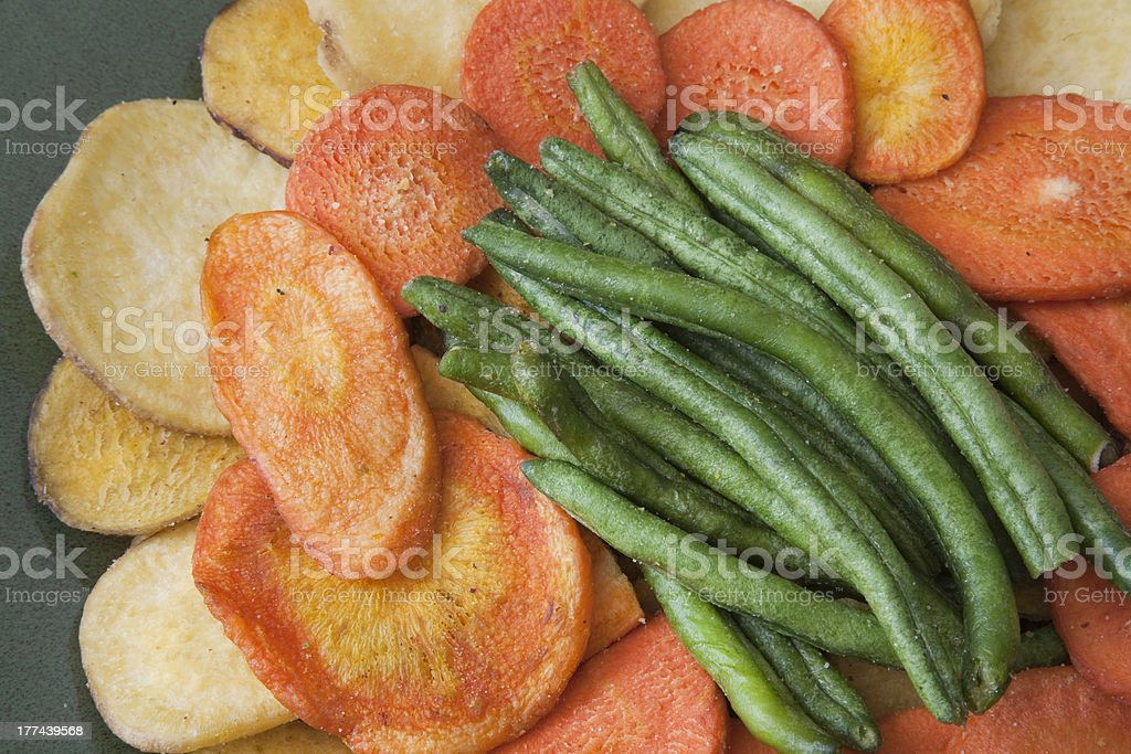 Vibrant Colored Dried Vegetables on Green Plate stock photo