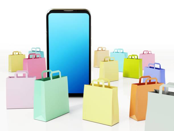 Lebendige, farbige Einkaufstaschen rund um modernes Smartphone mit blauem Bildschirm – Foto