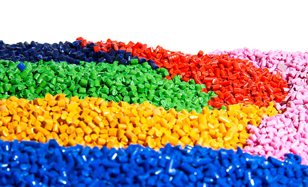 Vibrant colorful pieces of tiny bits of plastic stock photo