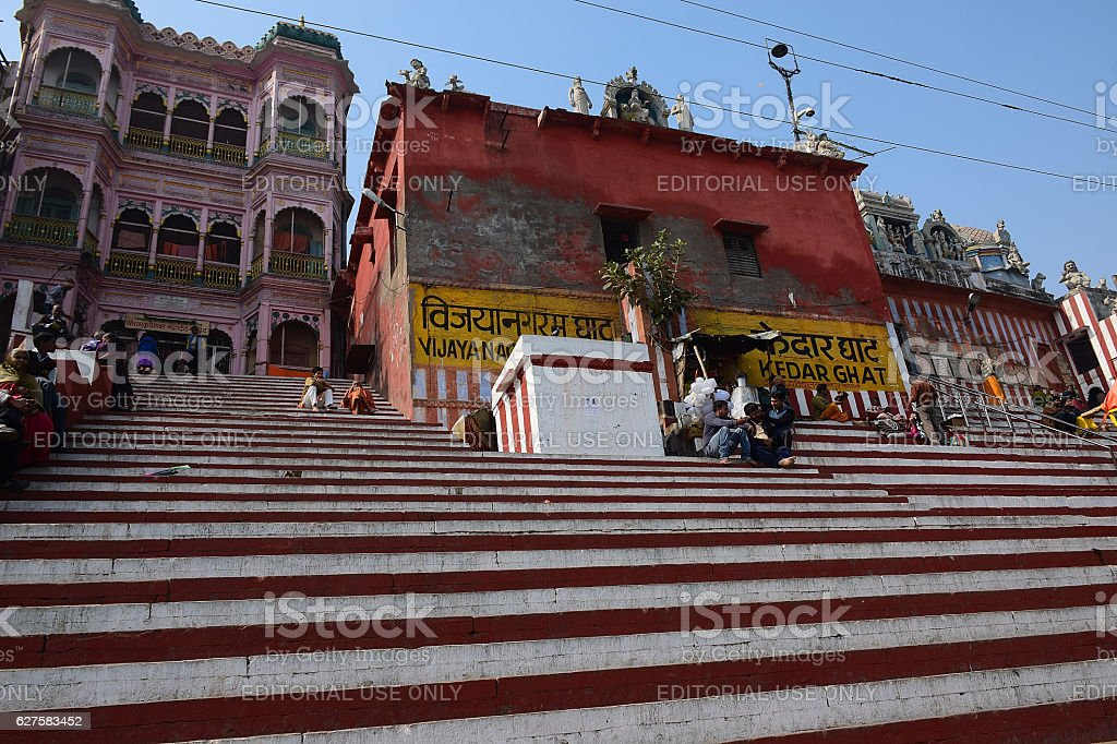 Vibrant colorful red steps at ganges river in Varanasi, India stock photo