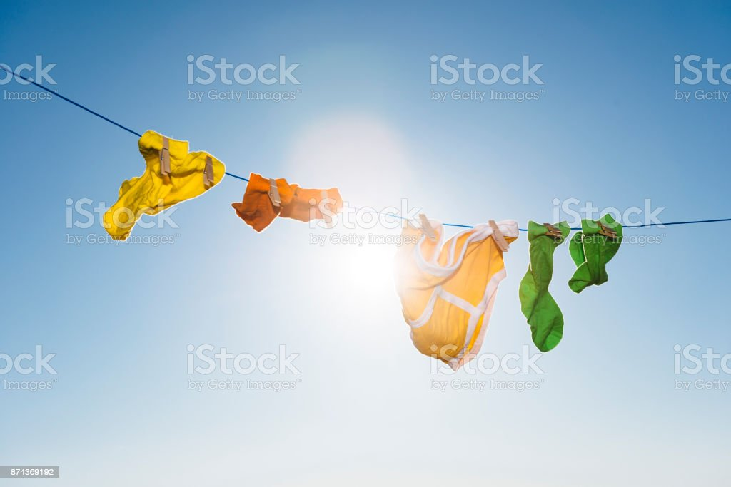 Vibrant coloured socks and retro Y-fronts on a washing line. stock photo
