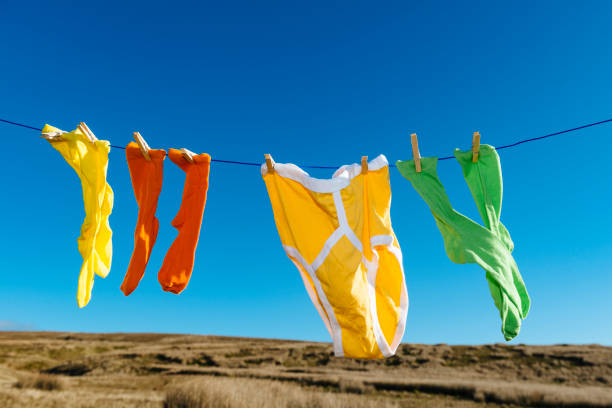 vibrant coloured socks and retro y-fronts on a washing line. - washing line stock photos and pictures