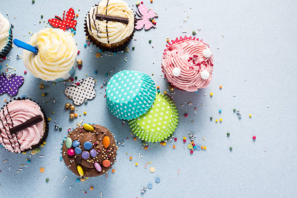 Vibrant cupcakes on blue background, party food concept stock photo