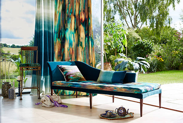 Vibrant day bed in modern home Vibrant day bed with cushions in modern home chaise longue stock pictures, royalty-free photos & images