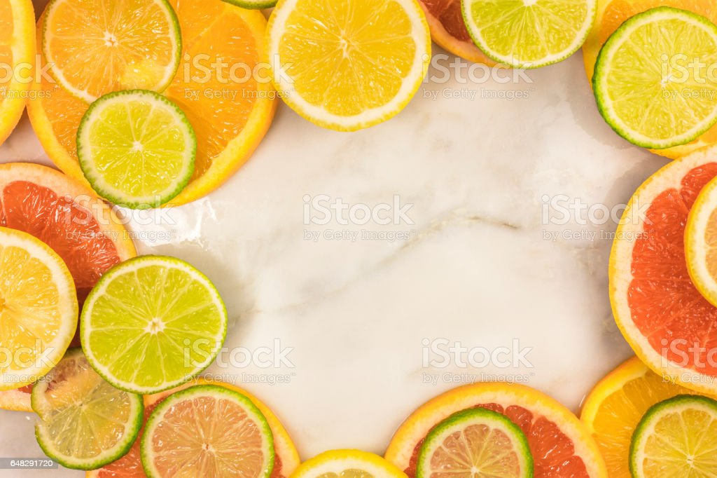 Vibrant frame made up of juicy citrus fruits stock photo