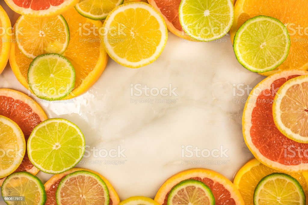Vibrant frame made up of juicy citrus fruits royalty-free stock photo