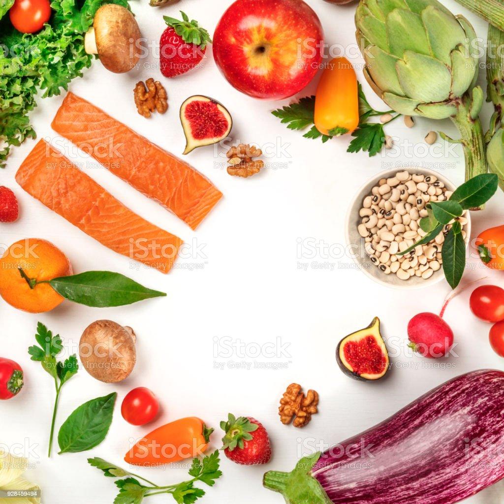 Vibrant fresh food, vegetables, fruits, legumes, fish on white stock photo