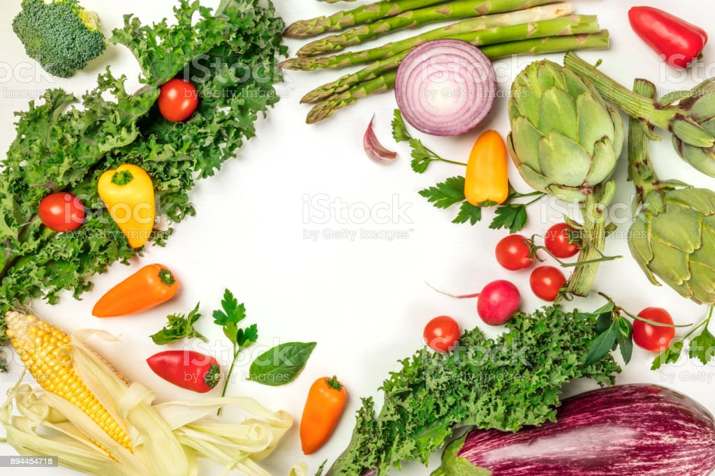 Vibrant fresh vegetables on white background with copyspace stock photo