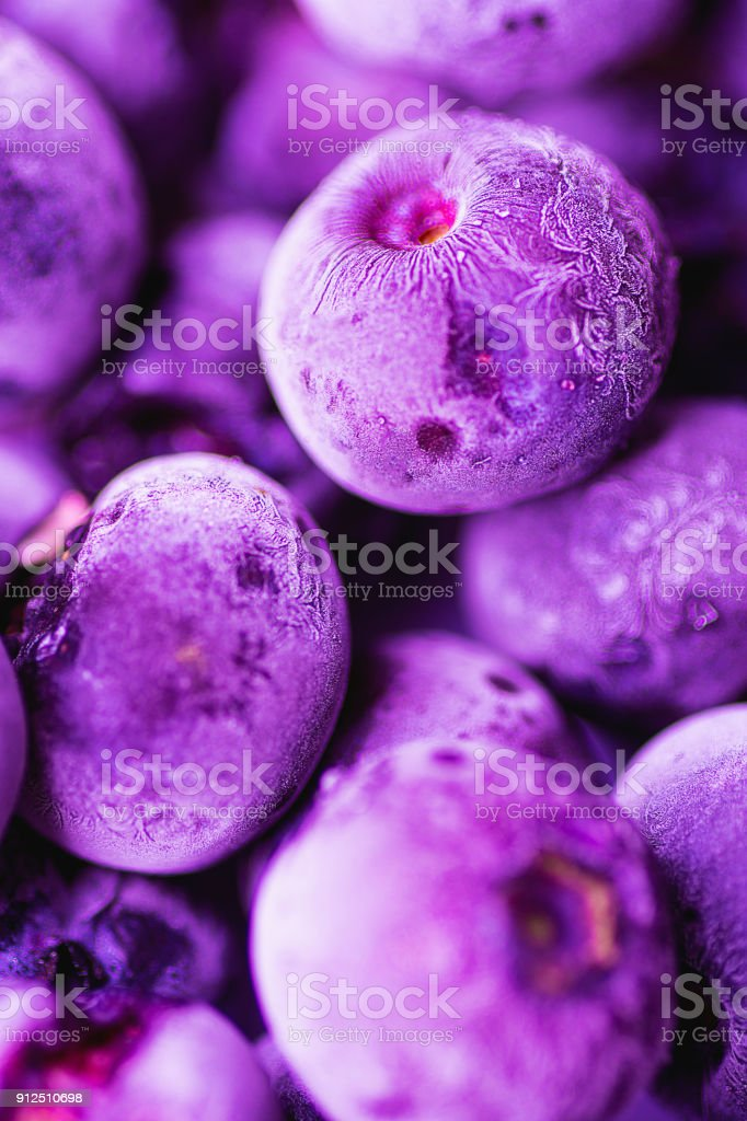 Vibrant Frozen Blueberries in Trendy Ultra Violet Color with Beautiful Frost Pattern and Texture. Summer Food Background for Blogs Posters Social Media. Elegant Creative Styled Image. Selective Focus stock photo