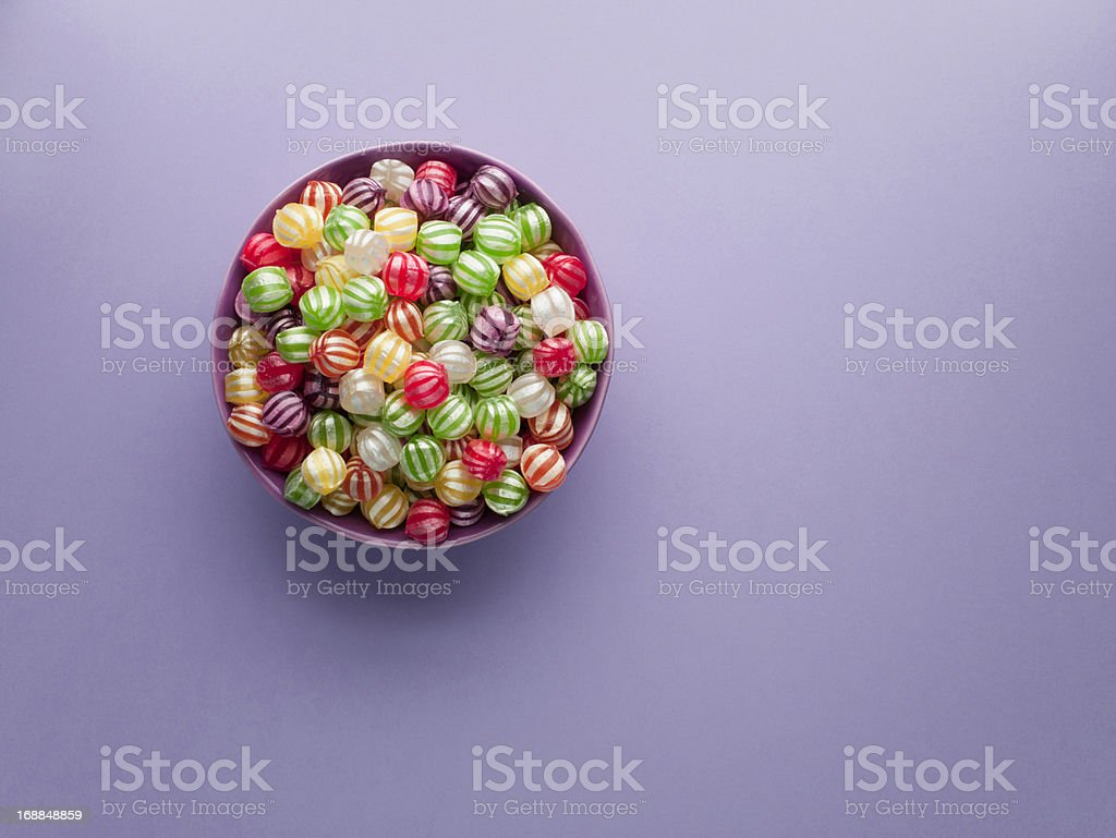 Vibrant hard candy in bowl stock photo