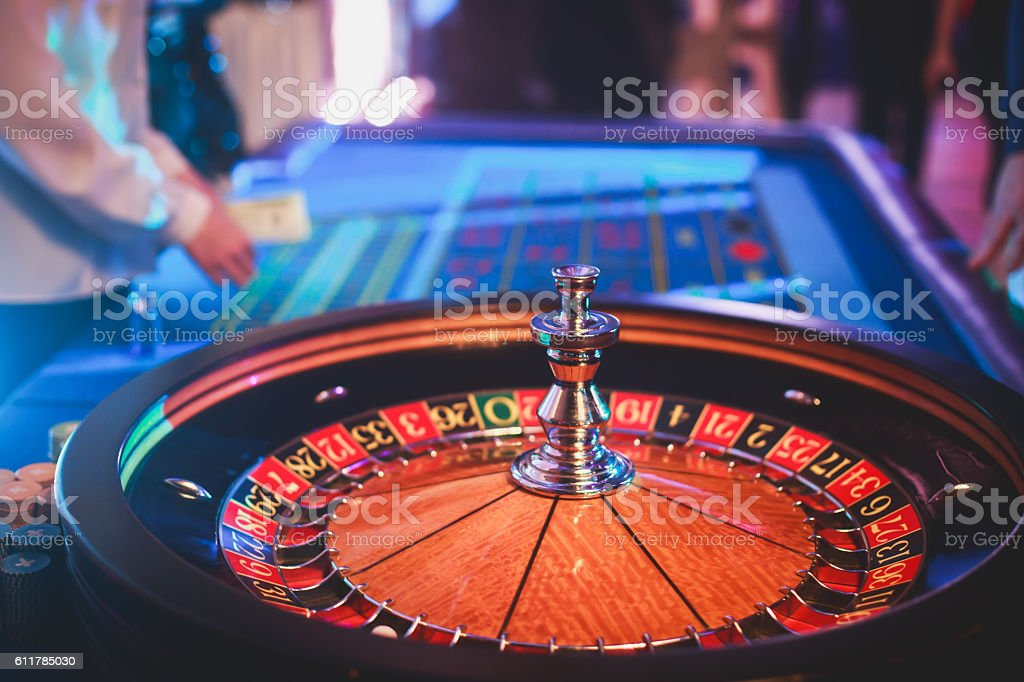 A close-up vibrant image of multicolored casino table with roulette...