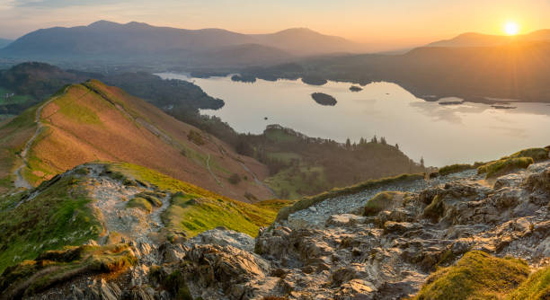 Vibrant Lake District Sunrise On A Calm Spring Morning. stock photo