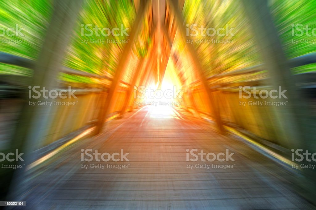 Vibrant light at the end of the tunnel abstract speed stock photo