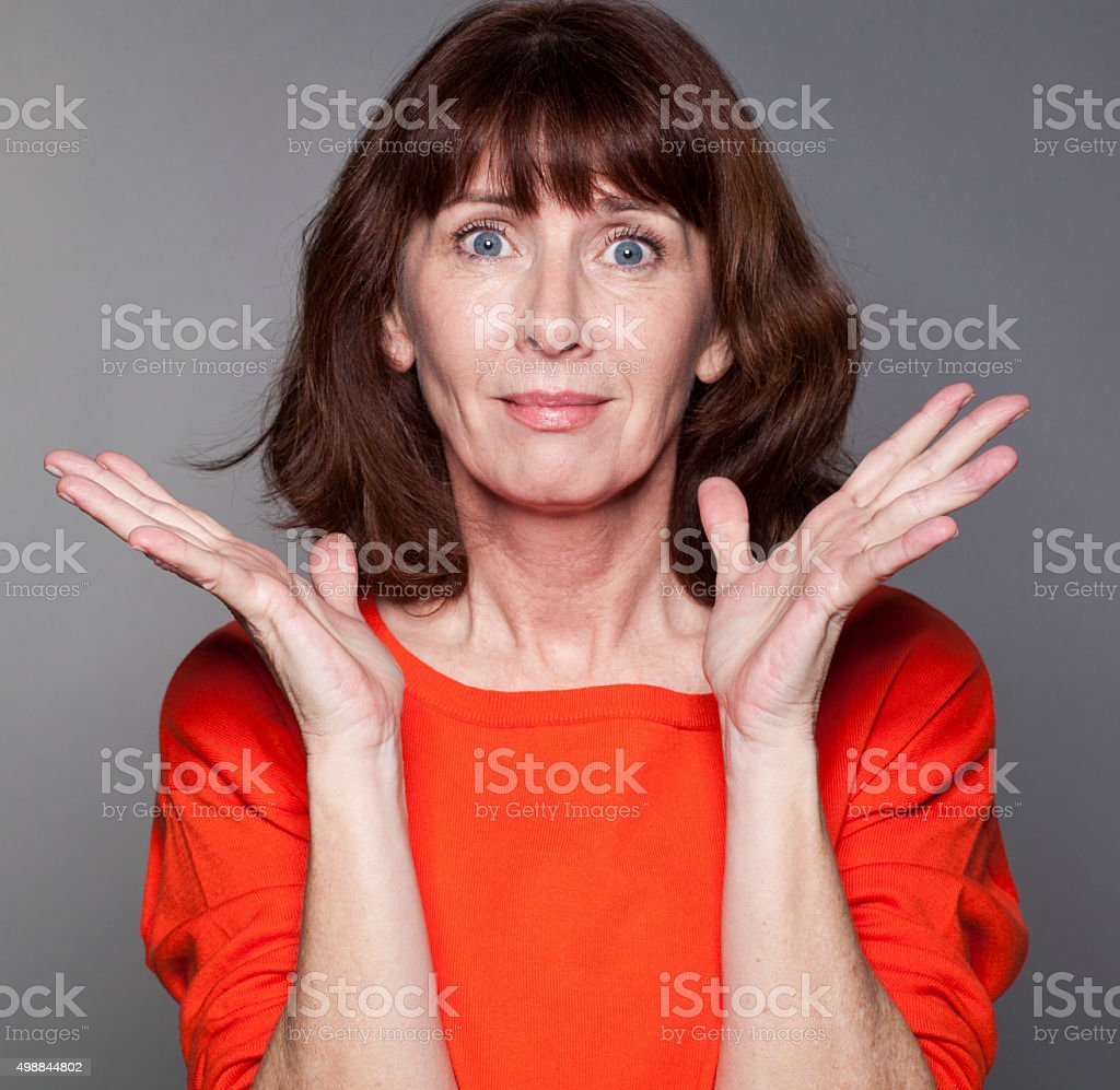 vibrant mature woman expressing hopelessness and blame with her face stock photo