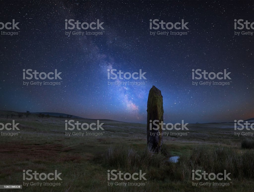 Vibrant Milky Way composite image over landscape of Ancient prehistoric stones in Wales stock photo