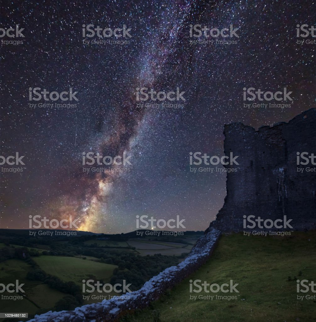 Vibrant Milky Way composite image over landscape of medieval castle ruins stock photo