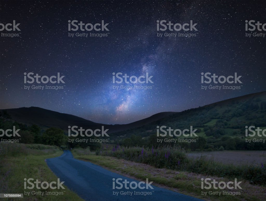 Vibrant Milky Way composite image over landscape of mountains in distance stock photo