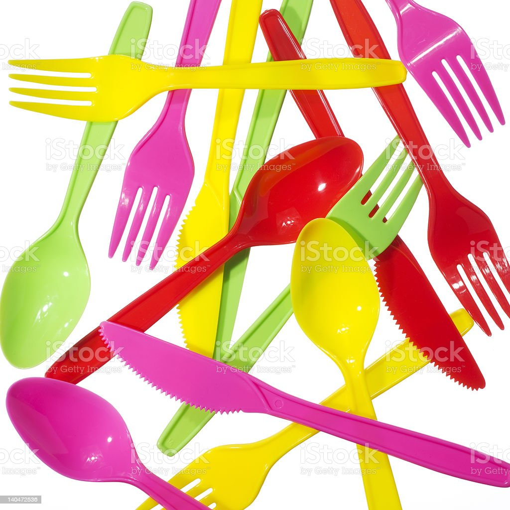 vibrant multicolored forks, kives and spoons royalty-free stock photo