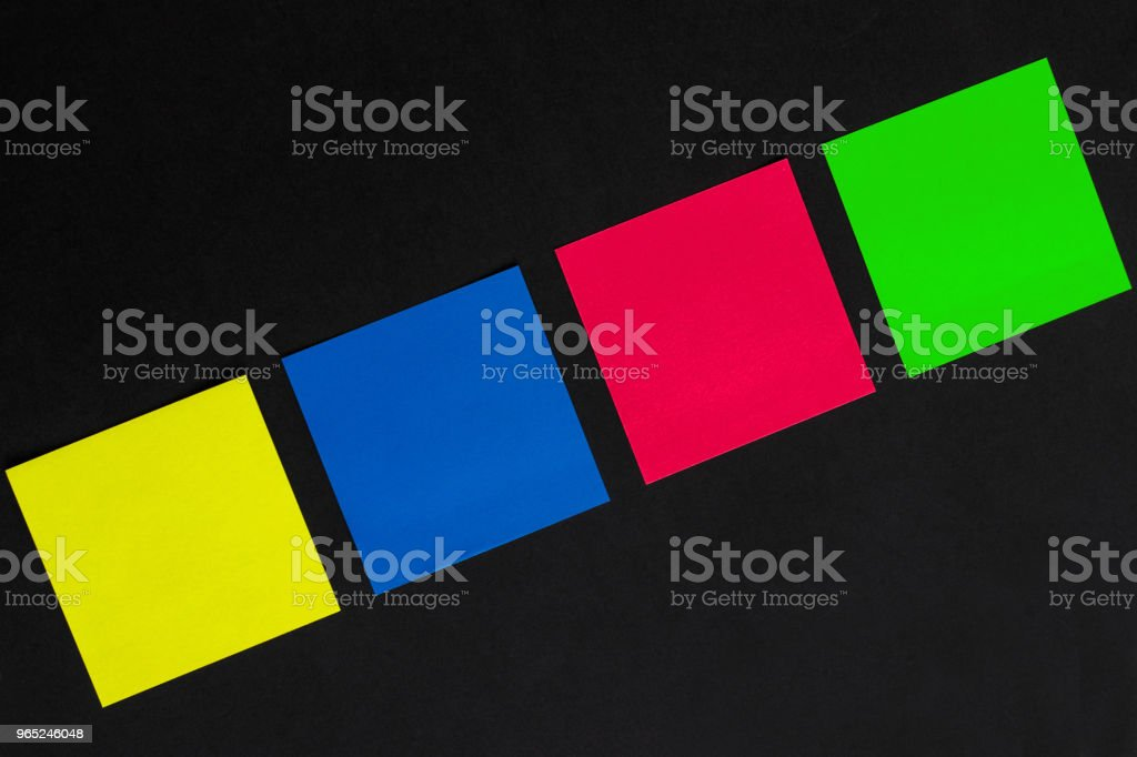 vibrant multicolored stickers on black background zbiór zdjęć royalty-free