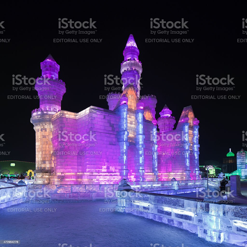 Vibrant neon lit castle-like ice building, Harbin, China stock photo