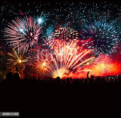 istock vibrant new years banner with  fireworks and cheering crowd 609942456