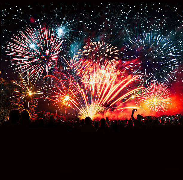 vibrant new years banner with  fireworks and cheering crowd vibrant new years banner with  fireworks and cheering crowd firework display stock pictures, royalty-free photos & images